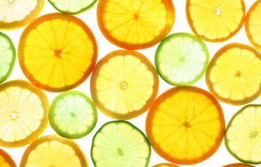 Sliced citrus fruits shiny background