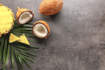 Pineapple and coconut on gray background