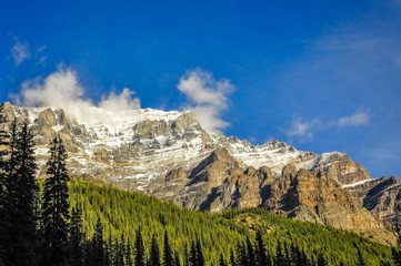 Sunny aspect of a mountain range in Banff National Park, Alberta, Canada.