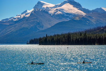 Canoeing at Lake Maligne  -the largest glacially fed lake in the Canadian Rockies in Jasper National Park, Alberta, Canada.