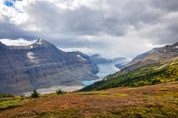 Break in the clouds at Saskatchewan glacier located near the Columbia Icefields in Banff National Park, Alberta, Canada.