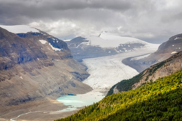 Saskatchewan glacier is located near the Columbia Icefields in Banff National Park, Alberta, Canada. Sunny aspect of the glacier as it was a break in between the clouds in a otherwise overcast day.