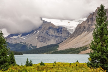 A cloud formation is going down the mountain at Bow lake and glacier in Banff National Park, Alberta, Canada.