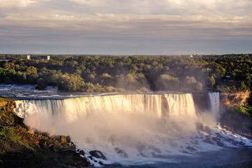 Niagara Falls is the collective name for three waterfalls located at the international border between Canada and the United States.