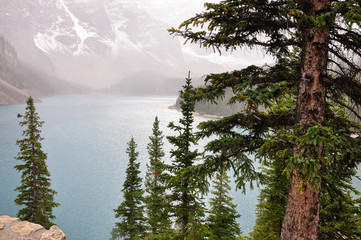 Fog is going down at Lake Moraine, Banff National Park, Canada