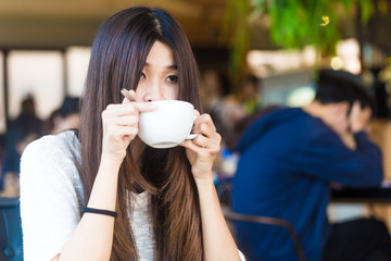 Women with white cup of hot coffee