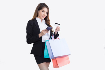 Beautiful  businesswoman with shopping bags