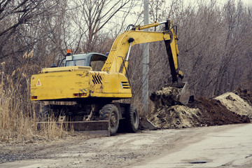 Excavator digs the earth
