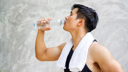 Man holding a bottle of water.