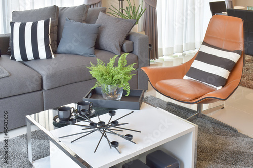 stylish living room comfortable. Exellent Stylish Stylish Living Room Design With Grey Pillows On Comfortable Sofa And Brown  Leather Chair And Stylish Living Room Comfortable O