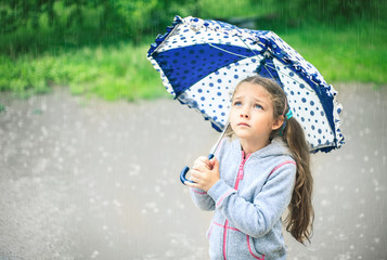 Portrait of a cute sad girl with an umbrella.
