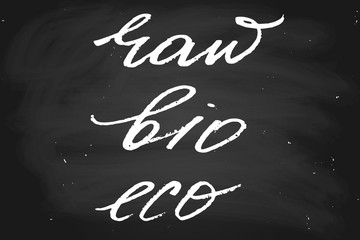 Raw bio eco. Handwritten text, chalk on a blackboard, vector. Each word is on the separate layer
