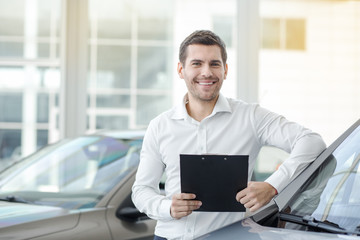 Young Man in a Car Rental Service Transportation Concept