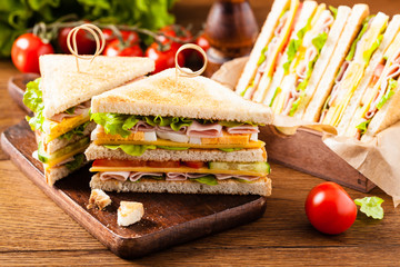 Photo on textile frame Snack Delicious toast sandwich with ham, cheese, egg and vegetables.