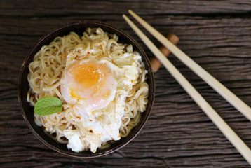 noodle in bowl on wood background top view