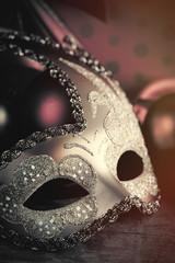 photo of beautiful masquerade mask on the wonderful brown studio background