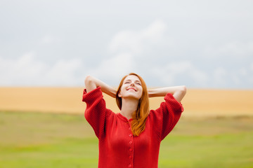 portrait of beautiful young woman on the wonderful field and sky background