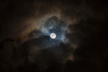 Full moon in a cloudy sky