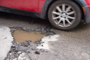 Large pothole in Montreal, Canada.