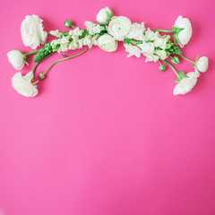 Floral frame made of white flowers - ranunculus and snapdragon on pink background. Flat lay, top view. Spring time background.