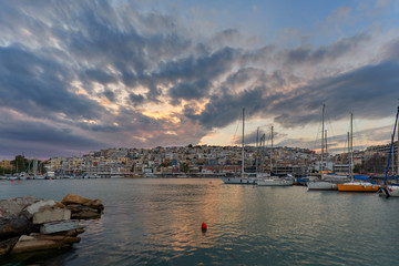 Sunset at Mikrolimano and view of Kastella hill in Greece