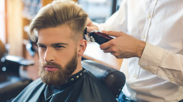 Young Man in Barbershop Hair Care Service Concept