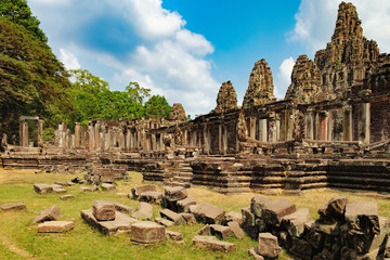 Prasat Bayon is surrounded by tropical trees, Siem Reap, Cambodia. Ancient Khmer temple with frescoes and columns, World Heritage