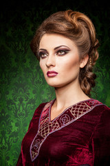 Sensual woman dressed vintage clothes in retro interior. Rococo period. Luxury and high class