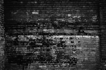 Rough brick wall, black and white photo. Grunge background