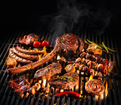 Assorted delicious grilled meat on a barbecue