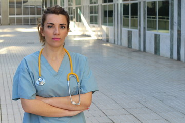 Healthcare professional with arms crossed - Stock image