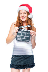 Vertical portrait of an actress with a rattle of a movie in a santa hat isolated