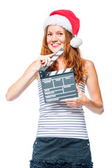 Vertical portrait of a female cinematographer with a movie clapper at Christmas