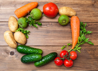 Mix of fresh vegetables on a wooden table. The concept of a healthy diet