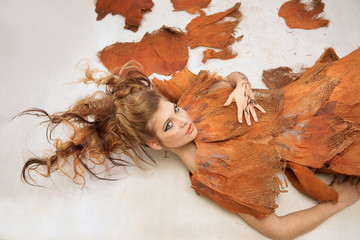 Woman in an orange fancy outfit, fashion, studio