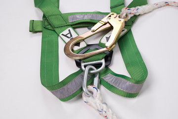 Closeup fall protection Hook harness and lanyard for work at heights on white background.