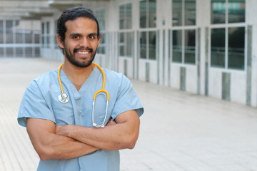 Ethnic doctor man posing happy with arms crossed - Stock image with Copy Space