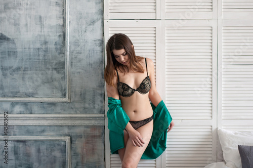 2a8ac46fe1 plus size female in lingerie and dressing gown posing in vintage studio