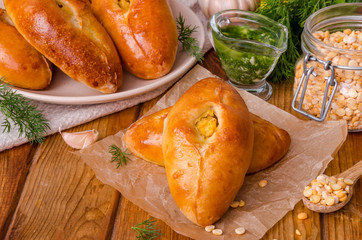 raditional Russian and Ukrainian yeast mini pies with peas and garlic sauce