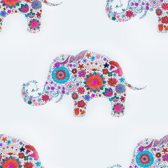 Seamless pattern of an elephant in flowers on a white background.