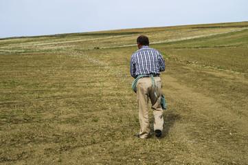 Farmers who fertilize the field with primitive methods, fertilized field pictures, agricultural fertilizer
