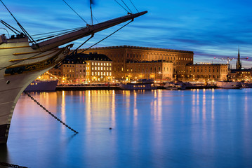 Stockholm night image with vintage ship and Royal Palace.