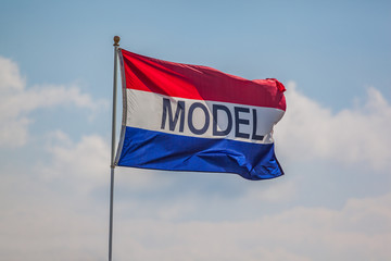 MODEL flag blowing in the wind
