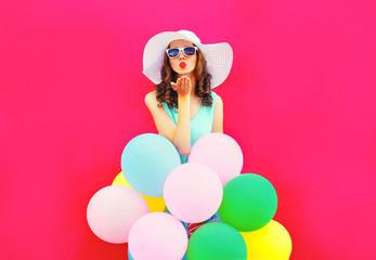 Keuken foto achterwand Kinderkamer Fashion woman is sends an air kiss holds an air colorful balloons on a pink background
