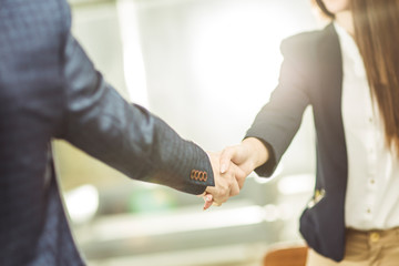 handshake business partners near the workplace