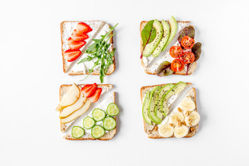 sandwiches set on white table background top view