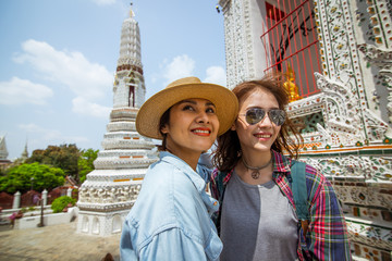 2 young ladies is exploring Watpo Thailand