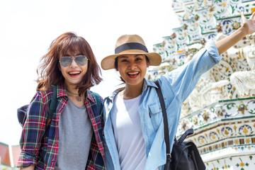2 young ladies is exploring Watpo Thailand