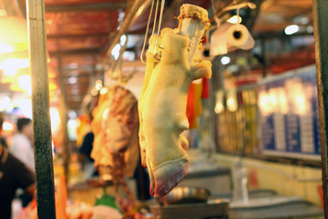 A row of Cow leg over a local market counter for sale. Selected Focus