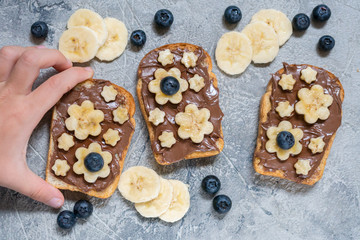 Toast bread with chocolate spread and banana